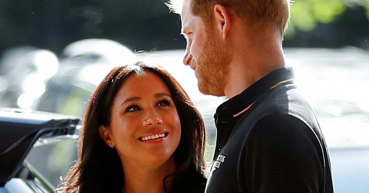 What Meghan Markle's secret hand gesture says about her feelings for Harry