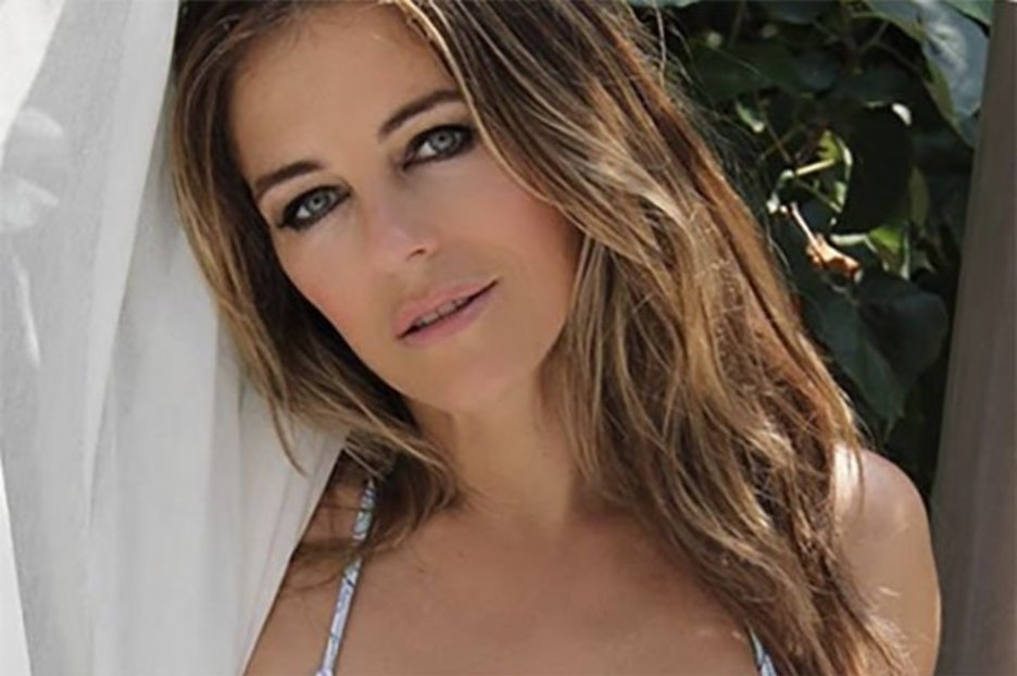 Liz Hurley, 54, gets fans fired up by squeezing into smoking hot striped bikini