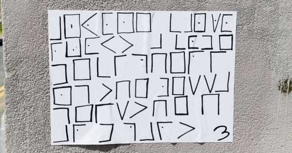 Street artist enthralls town with coded notes – and some people have cracked it