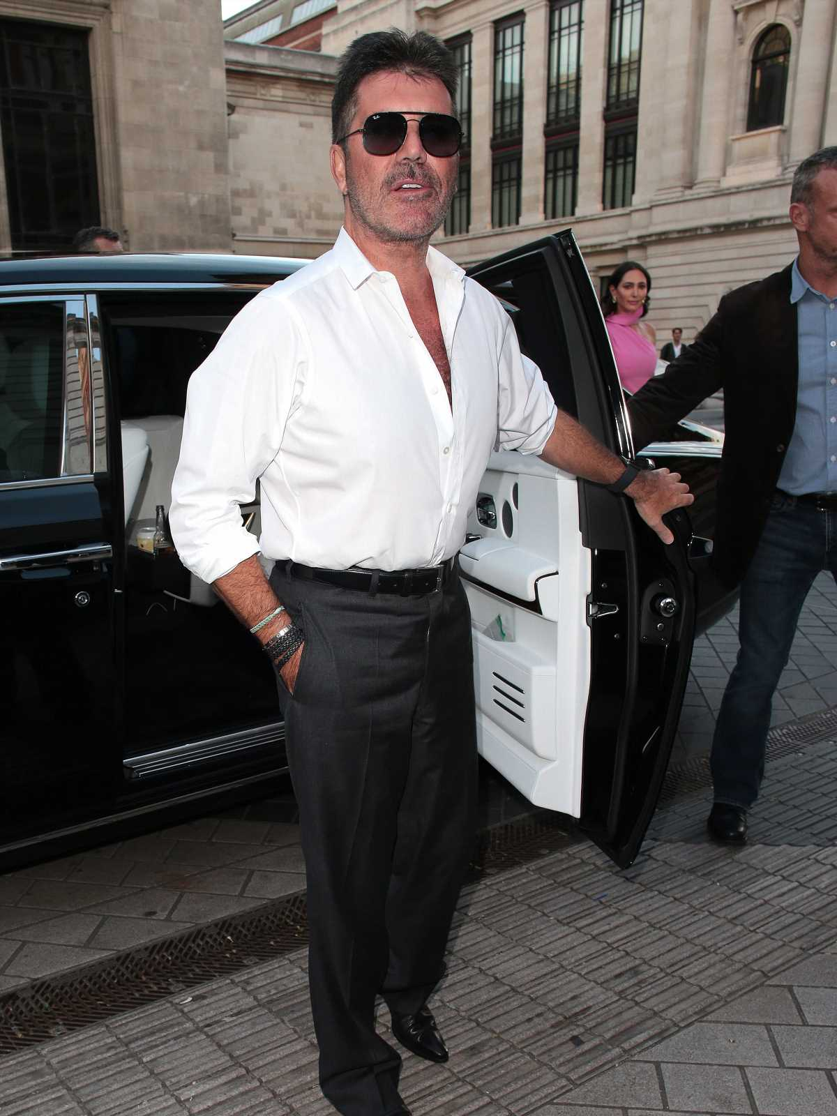 Simon Cowell secretly has a hot new body after doing toilet workouts
