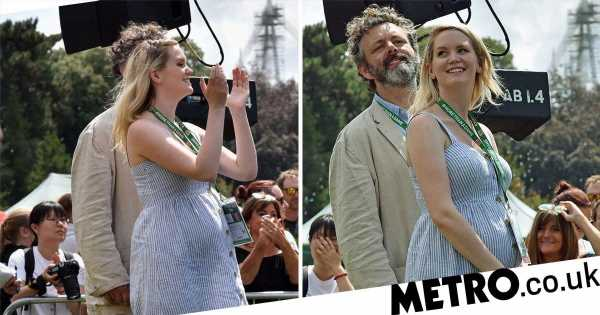 Michael Sheen's pregnant girlfriend Anna Lundberg cradles growing baby bump