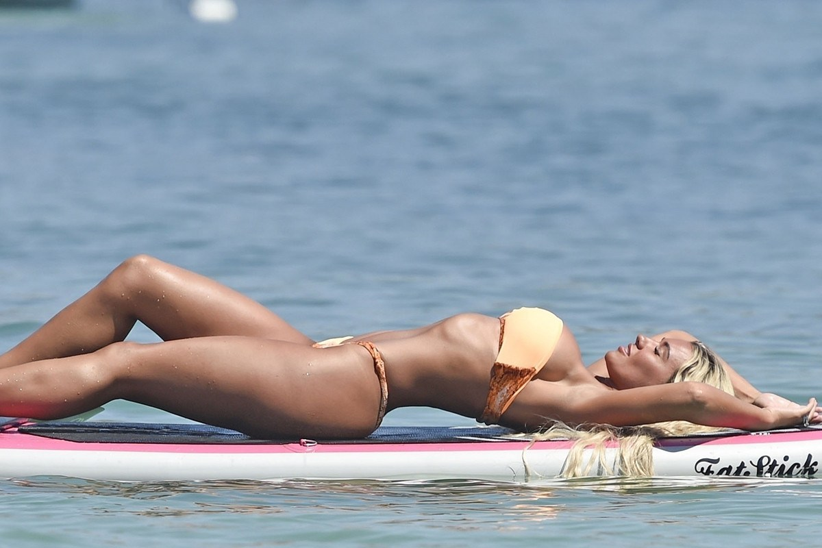 Christine McGuinness looks sensational as she frolics on a paddleboard in her bikini in Spain
