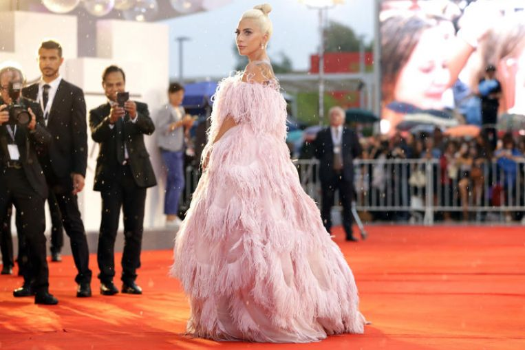 In three shaken US cities, Lady Gaga tries to channel 'fury into hope'