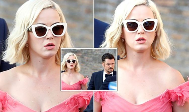 Katy Perry bares cleavage in bold pink gown with Orlando Bloom for Misha Nonoo's wedding