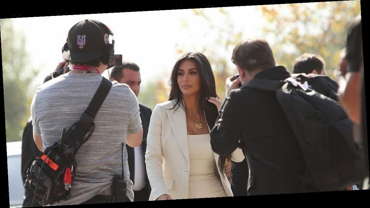 Kim Kardashian turns sexy secretary in curve-skimming trouser suit in Armenia