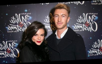 Faye Brookes cosies up to personal trainer Joe Davies on the red carpet following split from Gareth Gates