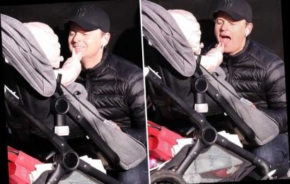 Dec Donnelly plays with baby Isla in adorable pictures as he does Christmas shopping with wife Ali Astall in London