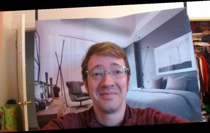 A software engineer working from home tricked his colleagues into thinking he lives in luxury apartment by hanging a backdrop behind him
