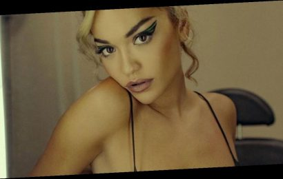 Rita Ora flashes boobs as she strips to transparent top in eye-popping snaps