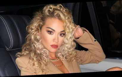 Rita Ora goes braless in blazer and skintight leather shorts for sizzling snap