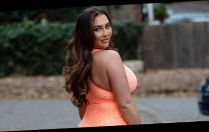 Lauren Goodger flaunts curves and peachy bum in orange workout gear after 'moving Charles Drury in'