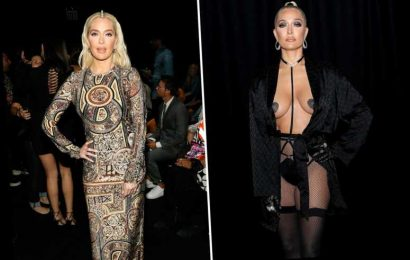 RHOBH's Erika Jayne flashes cleavage and glitter pasties as she poses in fishnets at Rihanna's sexy Savage X Fenty show