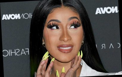 Of course Cardi B matched her lime-green hair to her car
