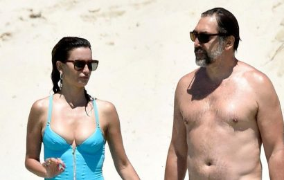 Penelope Cruz, 47, rocks a plunging swimsuit while enjoying a beach day with Javier Bardem in Sardinia